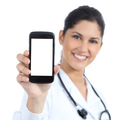 Female doctor smiling and showing a blank smart phone screen