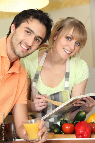 Couple following a recipe