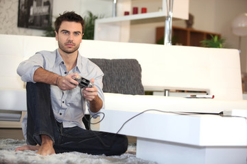 Man playing video games alone
