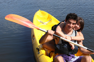 young couple canoeing in lake