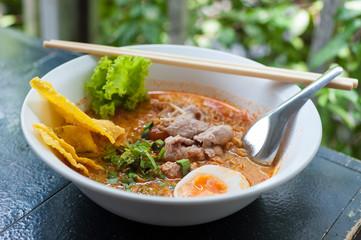 Pork noodle tom yum, condensed water egg.
