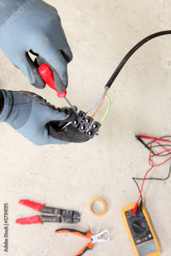 Electrician wiring a house