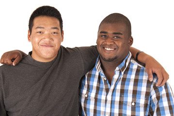 Black and Asian brothers with arms around each other smiling