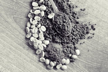 Coffee beans and coffee on wooden table in black and white
