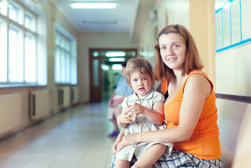 woman with child waits to doctor receive