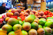 Mangoes and other fruits on counter