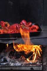 Red bell peppers on fire