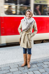 Young Woman at Tram Stop