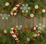 Conifer background with baubles and snowflakes