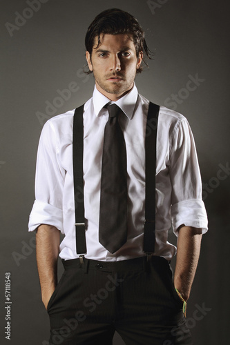 Handsome fashion model  with black tie