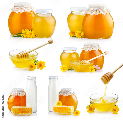 Set of sweet honey in glass jars with flowers and dipper isolate