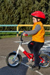 Small boy riding his bicycle