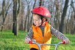 Little boy playing with his bicycle