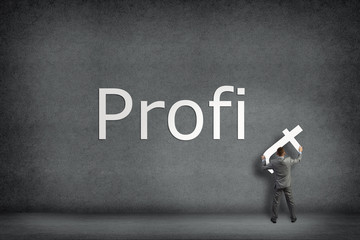 Businessman collects on the wall the word profit