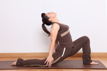 woman doing yoga exercise called Virabhadrasana