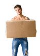 Handsome young man shirtless holding big cardboard box