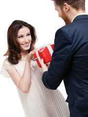 Man wonders his girlfriend with present, isolated on white
