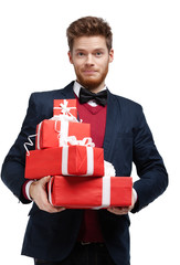 Young man hands a lot of Christmas presents, isolated on white