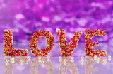 "Word ""Love"" on purple background"