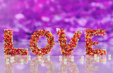 "Word ""Love"" on purple background"