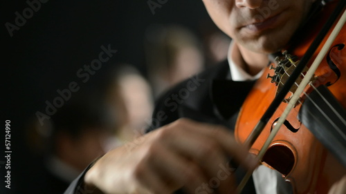 Classical music: Violinist playing at the concert