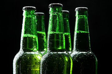 Bottles of beer on black background
