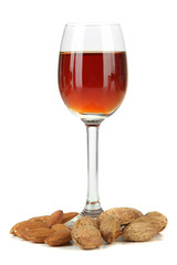 Glass of amaretto liquor and roasted almonds, isolated on white