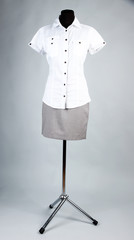 Nice blouse and gray skirt on mannequin,  on gray background