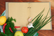 Cooking concept. Groceries with empty cookbook close up