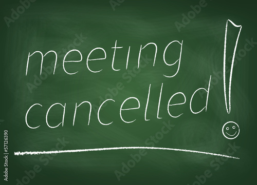 "The chalkboard on which is written in chalk "" Meeting cancelled"""