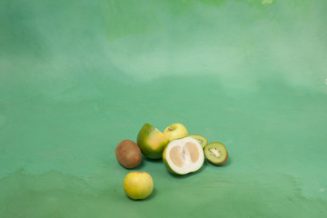 card with green fruits on a green background