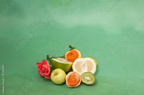 card with roses and fruits on a green background
