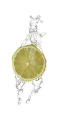 water being poured in a slice of lime isolated on white