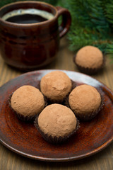 chocolate truffles and a cup of coffee, selective focus
