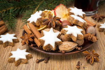 cookies in the shape of stars with icing and spices on wood
