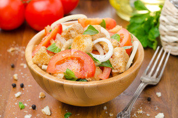 Italian salad panzanella with tomatoes, onions and croutons