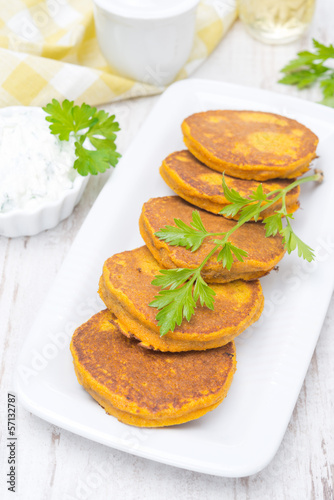 Pumpkin fritters with herbs, top view