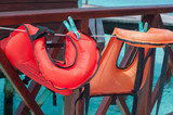 the life vests hang on a clothesline
