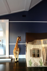 Stuffed giraffe and playhouse