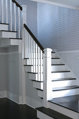 White staircase leading upstairs