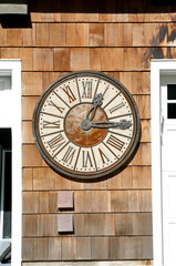 Old fashioned clock on exterior wall