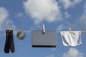 Laptop CD And Clothes On Clothesline