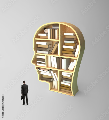 businessman looking at book shelf