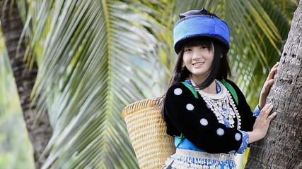 cute asian young girl in hill tribe costume of northern thailand