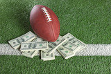 NFL football on field with a pile of money poster