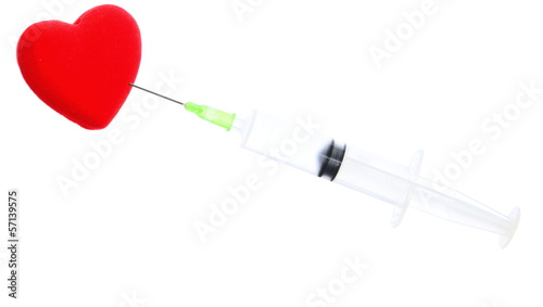 Health care syringe and red heart isolated