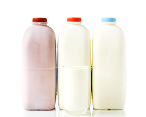 Bottles of Milk on Isolated White Background