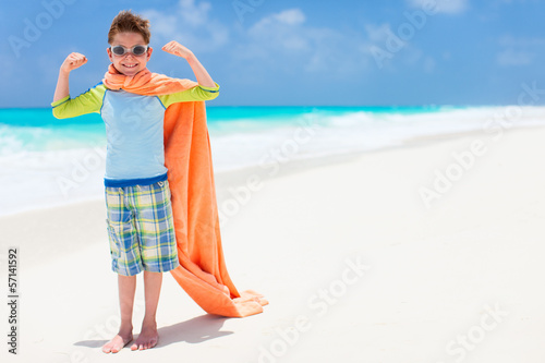 Superhero play at a beach