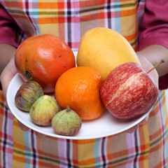 Fruit plate with  apple,fig, orange,pamogranate
