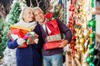 Couple Shopping In Christmas Store